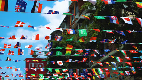 Fluttering flags of all states on the streets of the city, the unity of nations Footage