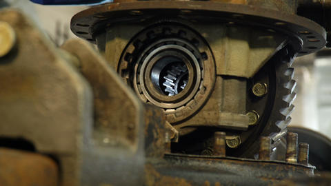 camera shows large rusted truck parts fixed in workshop Footage