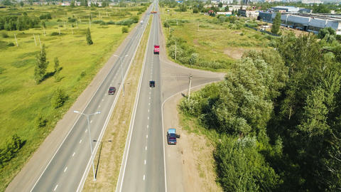 modern road with autos near large truck service station aerial GIF