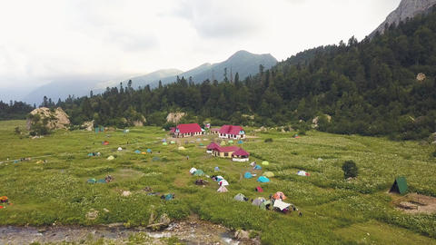 Tourist hotel and camping for summer holidays during mountain hike Live Action