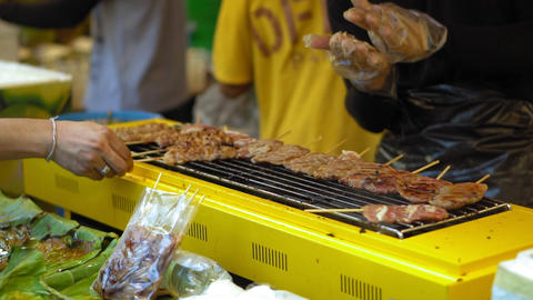 street food in Asia. traditional dishes of street cuisine. night food markets Live Action