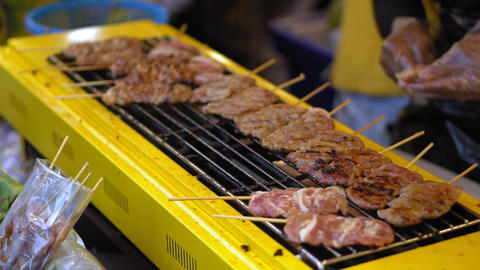 street food in Asia. traditional dishes of street cuisine. night food markets Footage