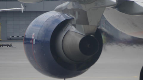 Back view of working jet engine and heat haze from it GIF