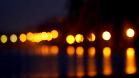 Bright night lights are reflected in sea water against the background of multi Footage