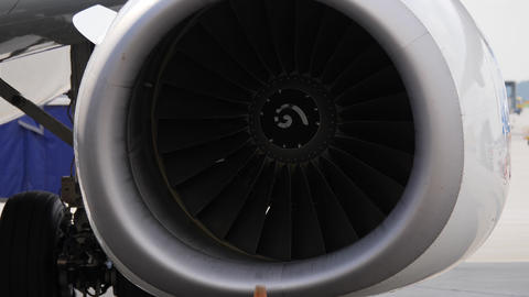 Close up of jet engine. Aircraft with stopped turbines stays on airport ramp Live Action