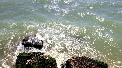 Sea water hitting rocks on the shore Footage