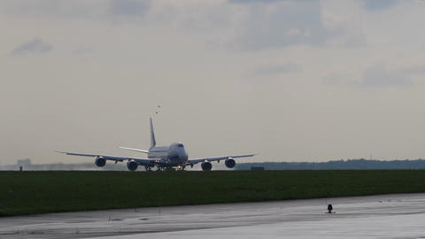 Takeoff run of Jumbo Jet. Cargo aircraft takes off from runway against cloudy Footage