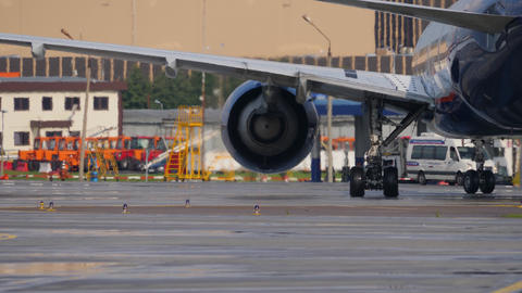 Airport buildings and equipment through heat haze from Boeing 777 jet engine GIF