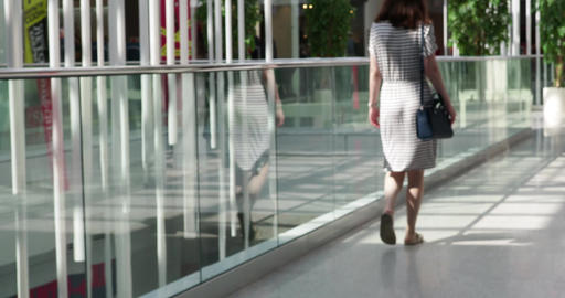Rear view of woman walking in shopping center Live Action