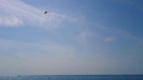 Powerboat pulls a parachute in the sky 영상물