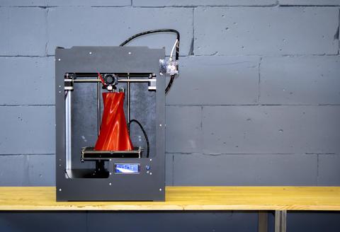 3D printer working close up. Automatic three dimensional 3d printer Photo