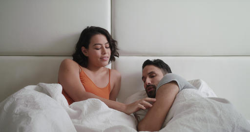 Woman Trying Sexual Approach With Man In Bed At Home Live Action