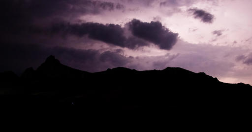 Thunder flashes at night over the mountain peak Timelapse Footage