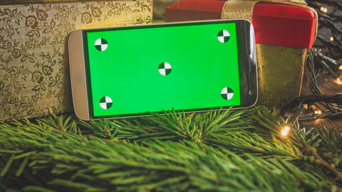CLoseup toned image of mobile phone with empty green screen for inserting your Photo