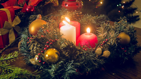 Toned image of three burning candles in decorative Christmas wreath Fotografía