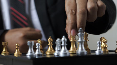 Hand of business man and woman playing chess GIF