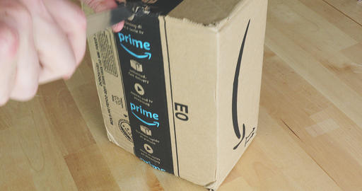 Unpacking Unboxing Cardboard Box From Amazon Prime Footage