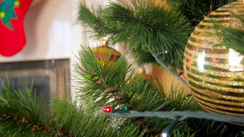 Closeup 4k video of camera moving through branches of decroated Christmas tree Footage