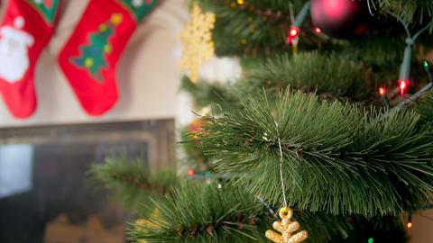 Closeup 4k footage of camera moving towards beautiful decorated Christmas tree Footage