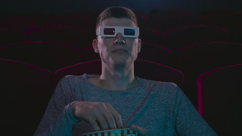 Man in 3d glasses eating popcorn wathing cinema 영상물