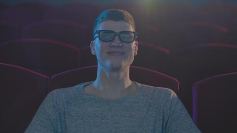 Man in 3d glasses watching funny movie in cinema Footage