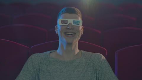 Man in 3d glasses eating popcorn wathing cinema Footage