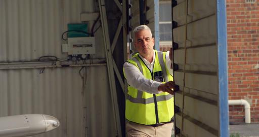 Male engineer opening shutter of hangar 4k Live Action