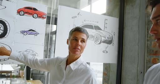 Car designers discussing over car design 4k Live Action
