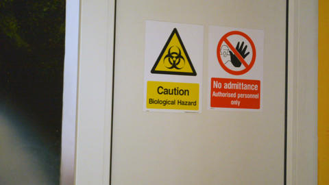 Man enters dangerous secret biological laboratory, door closes behind him Footage