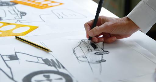 Car designer draw car design in office 4k Live Action