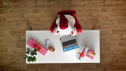 Santa Claus working at office on laptop, listening music in headphones, typing Footage