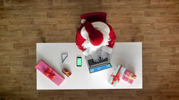 Santa Claus working at office on laptop, smartphone with chromakey, green screen Footage