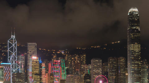 Modern buildings in city at night with colorful lights timelapse GIF