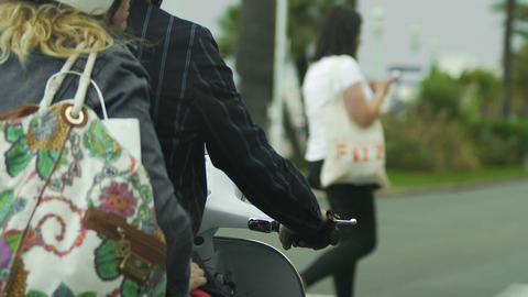 Motorcycle with two people on waiting at traffic lights, means of transportation Footage