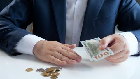 Closeup 4k footage of businessman choosing 100 paper US dollar bill instead of Footage