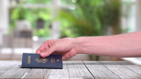 USA Passport landing on a desk Live Action
