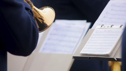 Orchestra musician reading notes and skillfully performing part on trumpet, show Footage
