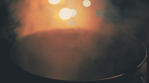 Magical decoction languidly smoking in huge cauldron, midnight witchcraft Live Action