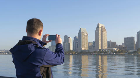 Tourist taking photo of dawn in San Diego skyline Footage