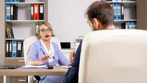 Beautiful blonde HR woman interviewing a candidate for the job Footage