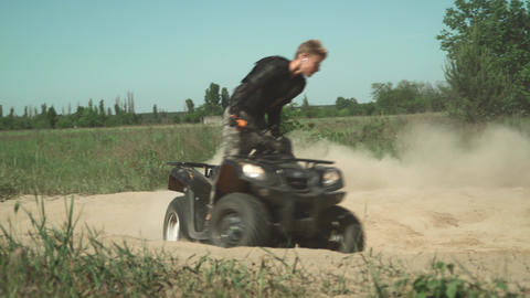 ATV rider doing circles on the field Footage