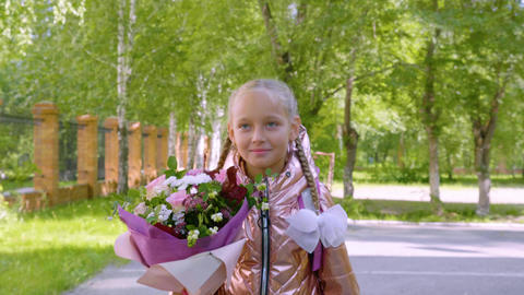 Portrait girl teenager with bouquet flower back to school. Girl going to school Footage