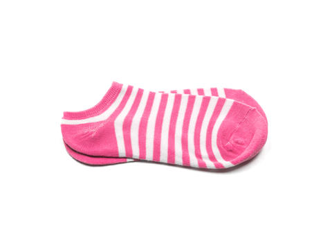 Cotton pink socks isolated on white background フォト