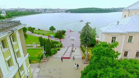 Aerial View. Beautiful view of the city, the embankment and the blue lake Footage