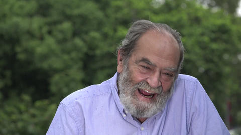 C0014 laughter of bearded hispanic senior old man Footage