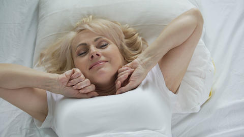 Optimistic middle-aged woman waking up early in the morning, vitality and energy Live Action