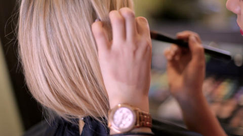 stylist artist work in her studio with a cosmetic brush Footage