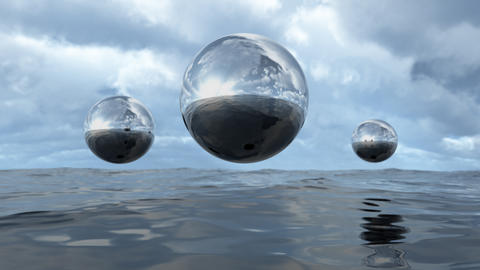 3D rendering abstract liquid transparent sphere above water フォト