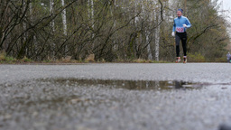 elderly male runner running through spring woods. slow motion Footage