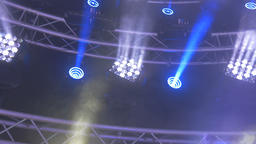 Led Stage Light Shining Different Colors and Spinning From the Rafters Footage